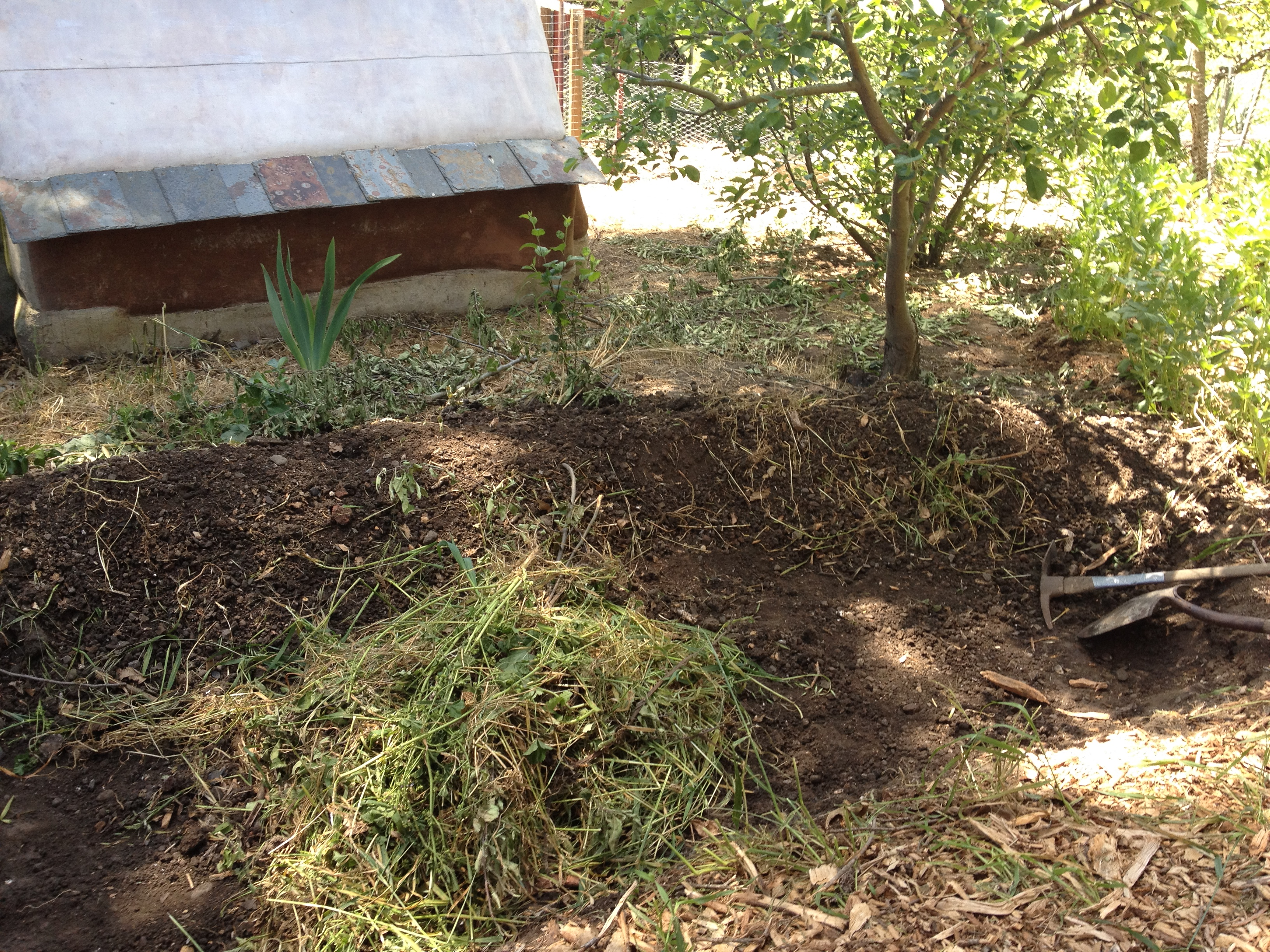 How to Make a Hugelkultur Raised Garden Bed | permacultureseniorproject